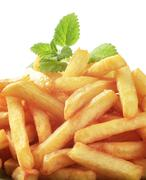 Heap of freshly fried French fries - detail - stock photo
