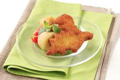 Stock Photo of Fried breaded fish with potatoes