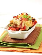 Fish and vegetable casserole topped with cheese - stock photo