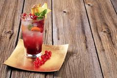Glass of iced drink garnished with fresh fruit Stock Photos