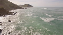 Aerial view of waves along wild coast Stock Footage