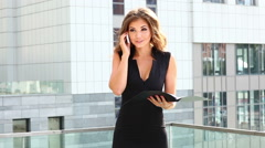 Business woman speaks on the phone and smiling. - stock footage