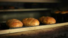 Baked bread in oven - stock footage