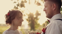 beautiful young couple bride and groom bouquet of sun glare in the park white - stock footage