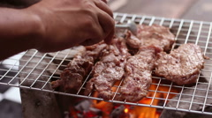 HD foootage of Chef cooking steak on flaming grill Stock Footage