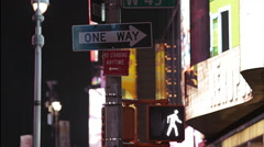 Close-up of crosswalk signal and one way sign Stock Footage