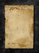 Stock Photo of old paper on grungy  wall