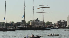 SAIL 2015 AMSTERDAM, AUGUST 19-23: Parade of boats at SAIL 2015, The Netherlands Stock Footage