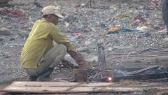 Worker gas cutting iron scrap parts Slowmo Stock Footage
