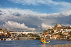 Gaia and Porto Cityscape from Douro River - stock photo