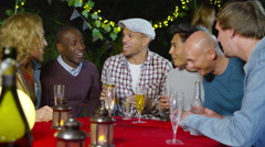 4K Happy male friends raise drinks for a toast at outdoor party  Stock Footage