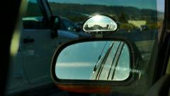 Car Driving - Side Mirror - 02 - Highway Traffic and Sun Stock Footage