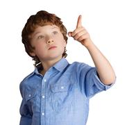 Handsome boy points with his finger. Isolated on white background - stock photo