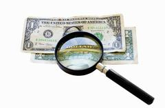 Two old one dollar bills under a magnifying glass Stock Photos
