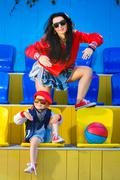 Rapper attitude rap singer hip Hop Dancer performing. Stylish woman and little Stock Photos