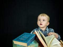 little baby boy hold book. Studio photo - stock photo