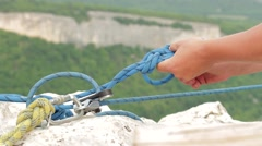climbing knots on a rope - stock footage