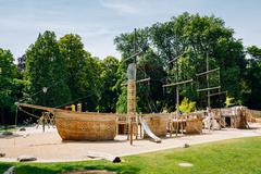 Wooden pirate boat shaped child playground in park - stock photo