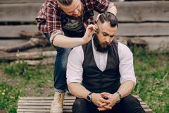 two bearded men shave - stock photo