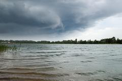 Storm clouds over  water - stock photo