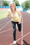 Runner - woman running outdoors Stock Photos