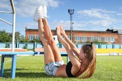 girl doing exercises for abdominal - stock photo
