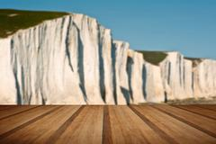 Stock Photo of Seven Sisters Cliffs South Downs England landscape with wooden planks floor
