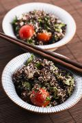 Tabbouleh Quinoa with tomatoes, onion, mint, parsley and lemon Stock Photos