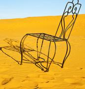 table and seat in desert  sahara morocco    africa yellow sand - stock photo