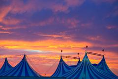 Circus tent in a dramatic sunset sky colorful - stock photo