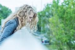 Woman standing on the bridge Kuvituskuvat