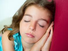 Beautiful brunete kid girl sleeping hands together Stock Photos