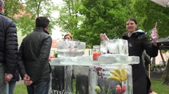 Woman sell natural fruit cocktails at ice frozen outdoor bar. 4K Stock Footage