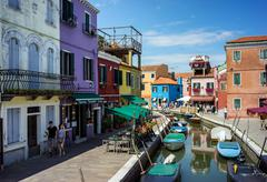 Burano island, architectural details of multi-colored houses of locals Stock Photos
