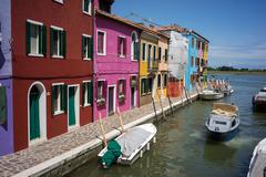 Burano island, architectural details of multi-colored houses of locals - stock photo