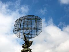 Military radar radio locator station antenna on background blue sky - stock photo