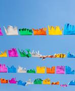 colorful tissue Paper fringe garland under blue sky - stock photo