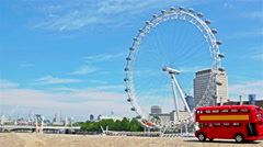 Stop motion of the famous London red bus toy passing by London Eye, part 2 Stock Footage