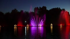 Musical floating fountain in  the river with city night lights - stock footage