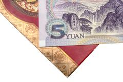 Chinese lucky money red envelope and Yuan - stock photo