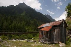 Old cottage in Caucasus mountain - stock photo
