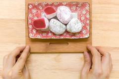 Stock Photo of Daifuku traditional Japanese dessert eaten with tea background.