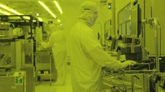 Workers in a Semiconductor manufacturing plant - stock footage