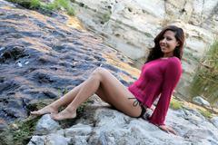 Hispanic Woman Creek - stock photo