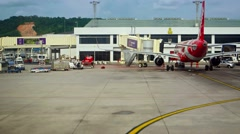 Taxiing Past the Passenger Terminal at Don Mueang International Airport Stock Footage
