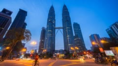 Night to day time lapse footage of junction traffic light in front of Suria KLCC Stock Footage