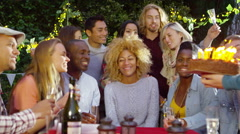 4K Happy group of friends at birthday party, woman embraces her friends - stock footage