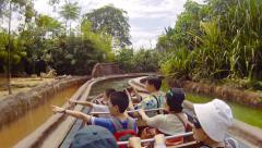 Tourists enjoying the water ride at Amazon River Quest in Singapore Stock Footage