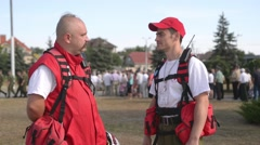 Representatives of the Red Cross work in crowded areas - stock footage