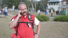 Red Cross representative talking on the phone Stock Footage